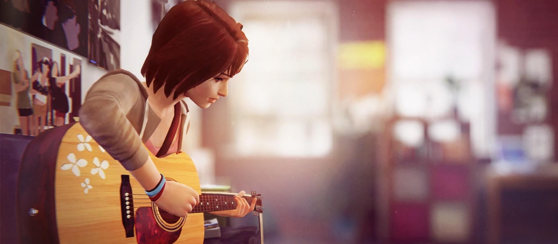 Max à la guitare